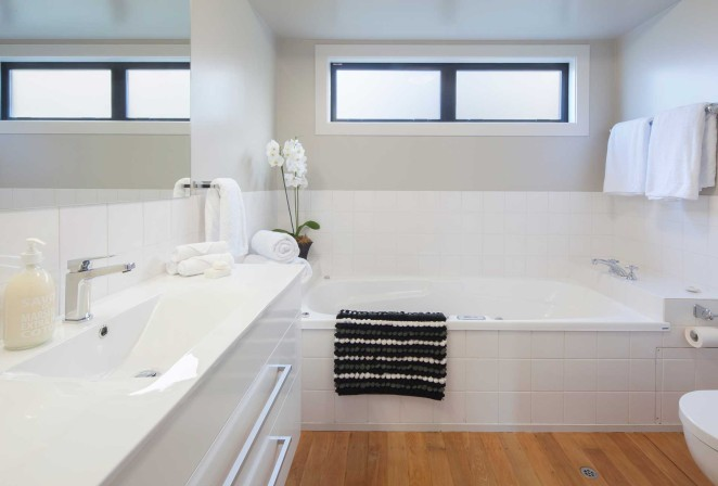 East Wing bathroom with large spa bath and shower