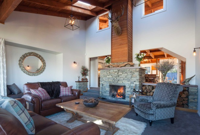 Spacious Lodge living room with roaring open fire