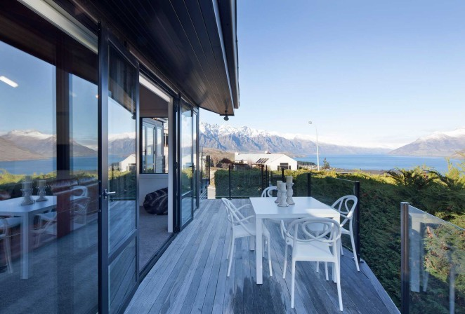 Secluded front deck with lake and mountain views