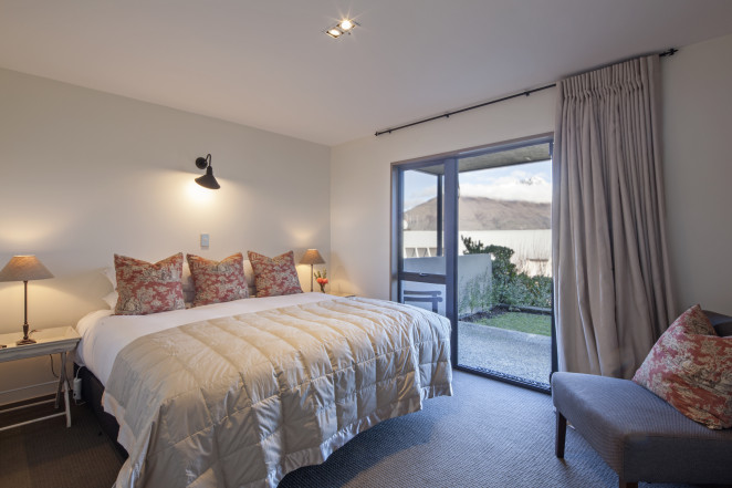 Lake View bedroom with private covered outdoor courtyard