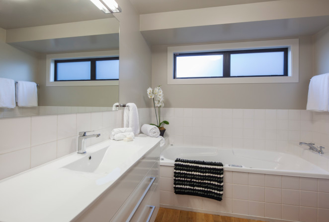 West Wing bathroom with large spa bath and shower